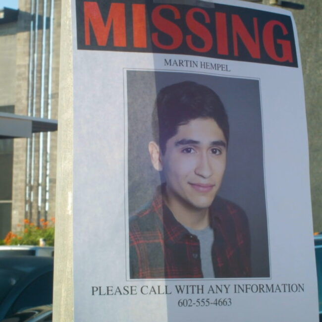 Loving Martin short film still image of a missing poster of a young man with black hair